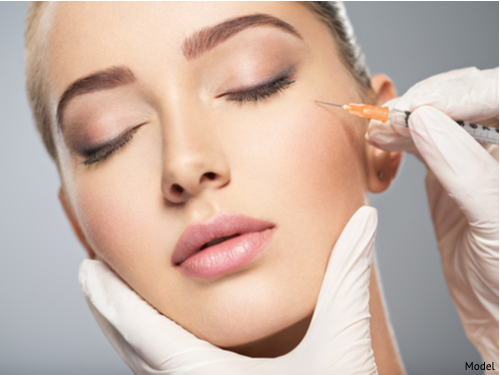 A woman about to receive BOTOX® injections on her cheek bones.